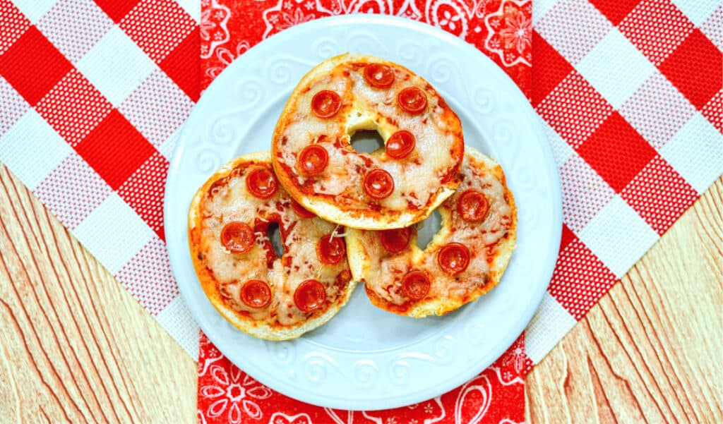 4 Ingredient Air Fryer Pizza Bagels! Doesn't get any easier than this, and kids will want in on the fun too! See all our great air fryer recipes at costcontessa.com