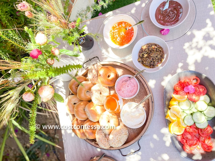 Costco Brunch Bagel Board - Bagels, Cream Cheese, Honey, Tapenade, Jam, Nutella, Cucumber, Tomato, Lemon | Complete Boho Budget Brunch Guide at CostContessa.com