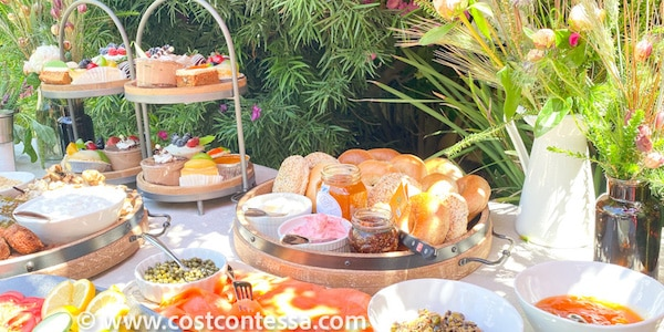 Sunday Brunch Casual Buffet with Bagels, Lox, Green Brunch Board and Desserts - Most of which we got at Costco! | Complete Boho Budget Brunch Guide at CostContessa.com
